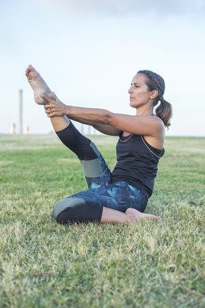 Beautiful girl is engaged in yoga in the park