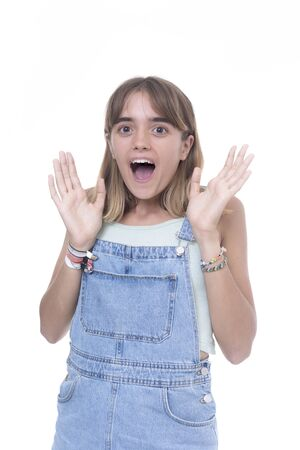 Surprised young female student over white background Imagens