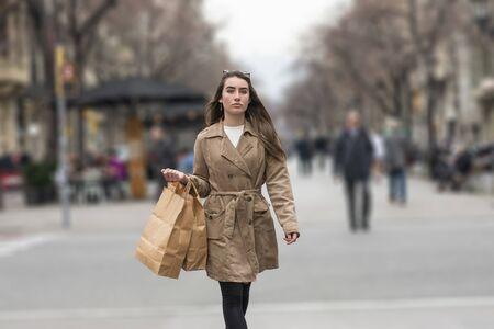 Woman shopping - shopper girl outdoors
