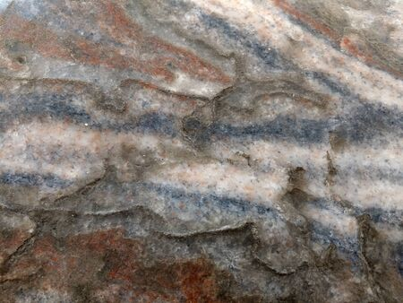 Texture. Polished mineral halite or rock salt. Blue, red, white layers