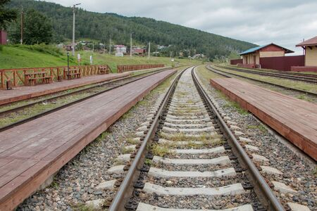 Rails extending into the distance. Close-up. Kultuk station of the old part of the Circum-Baikal Railway, Russia.