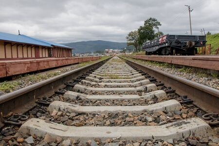Rails extending into the distance. Close-up. Kultuk station of the old part of the Circum-Baikal Railway, Russia. 写真素材