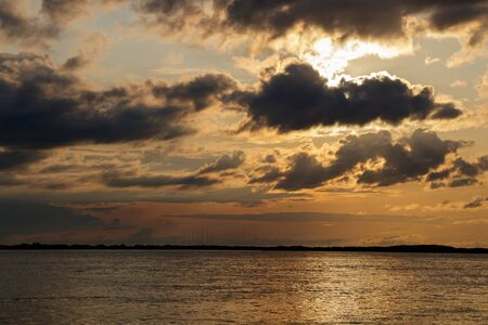 Sunset with black clouds on the Amur River, Khabarovsk Territory, Russia Banco de Imagens
