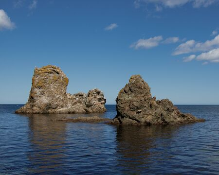 A beautiful stone outliers or rock formations near the coast of the Sea of Okhotsk. Cape Velikan, island Sakhalin, Russia