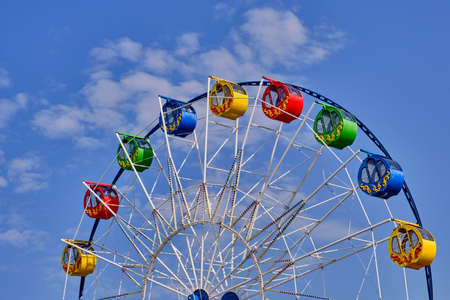 Part of a ferris wheel with round cabins decorated with ornaments