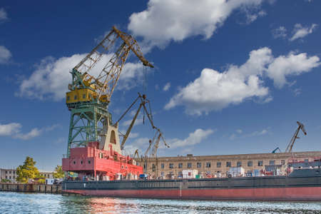 Crane on the background of old buildings of the Sevastopol Marine Plant named after Sergo Ordzhonikidze