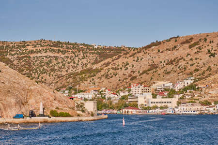 Entrance to Balaklava Bay from the Black Sea. View of the city of Sevastopol, Balaklava district. Russia, Crimea.