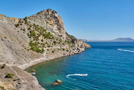 Crimean peninsula. People walk along the tourist route Golitsyn Trail. Botanical reserve New World. Stock Photo