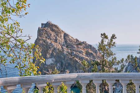 Rock Diva, the black sea coast near Yalta, Crimea. People walk on the suspension bridge, climb to the top, relax on the beach