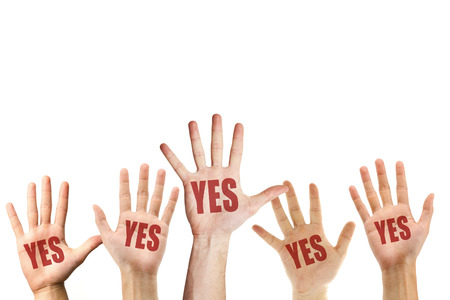 to raise: all raise hand to say yes Stock Photo