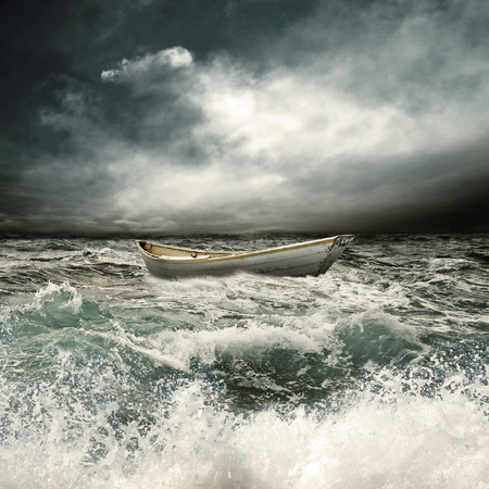 storm sea:  boat in danger situation Stock Photo