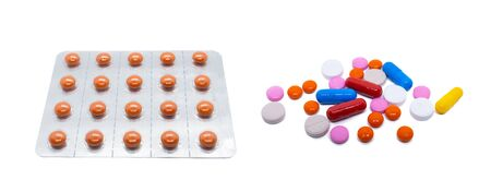Orange pills in a plastic blister. A scattering of colored pills and medicines. Isolated pills on white