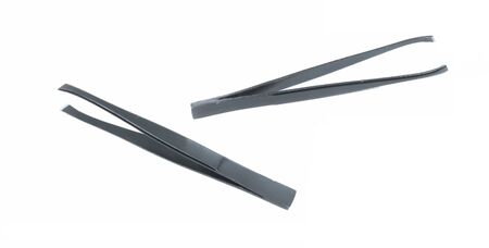 Black metal eyebrow tweezers. Female accessories for manicure and personal care isolated on white.