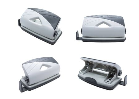 Grey Desktop Hole Punch isolated on white background. Front view, rear view, 45 degree angle view.