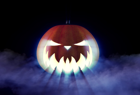 Scary Halloween Pumpkin looking through the smoke.