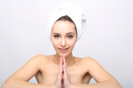 after bath: Beautiful Happy Spa Girl Isolated on a White Background.Touching  her Face. Happy Woman after Bath with Clean Perfect Skin