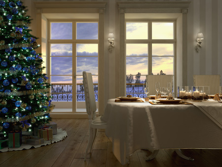 Christmas themed dinner table with a christmas tree Stock Photo