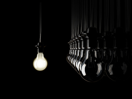 sense of space: An illuminated fluorescent light bulb connected to an electrical cable Stock Photo
