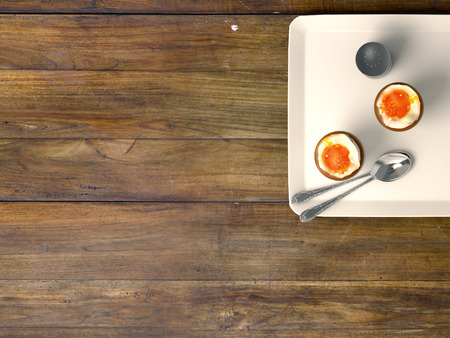 Fresh eggs on wood background. Top view photo