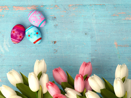 Hand-painted easter eggs with tulips  on wooden background photo