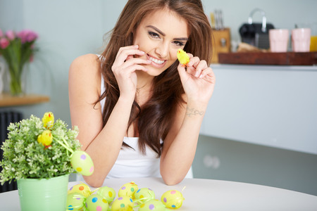 easteregg: a smiling female laughing with colorful easter eggs