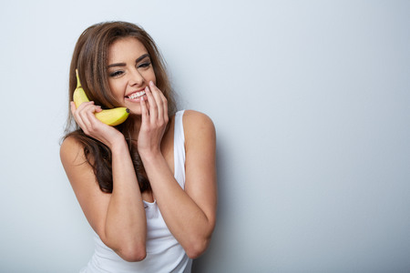 sexy food: a woman making fun with a banana