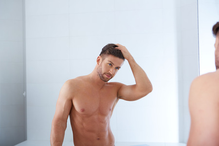 sexy bath: a handsome man in his bathroom, beauty care