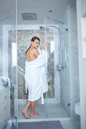 Beautiful woman on a spa day, bathroom Imagens