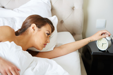 rested: Young beautiful, woman waking up fully rested. Stock Photo