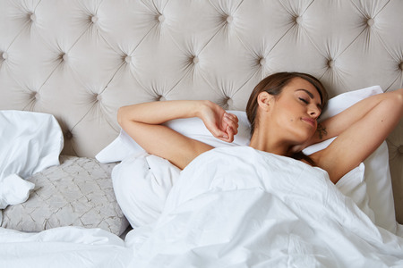 sleep well: Young beautiful, woman waking up fully rested. Stock Photo