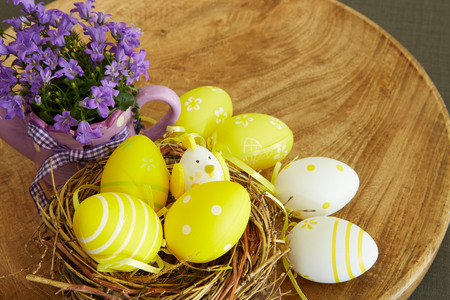 colorful easter eggs on a wooden background photo