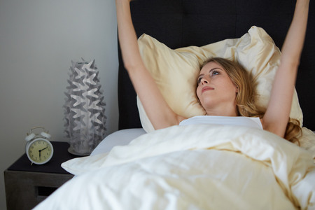 raised viewpoint: attractive woman stretching in the morning