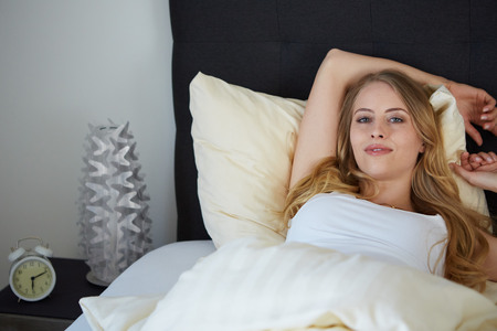 raised viewpoint: attractive woman on the bed in the morning