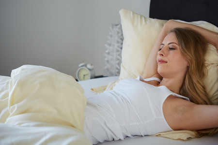 raised viewpoint: attractive woman on bed in the morning Stock Photo
