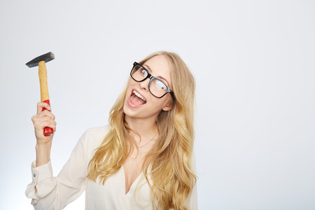 down beat: a young woman with hammer and nerd glasses.