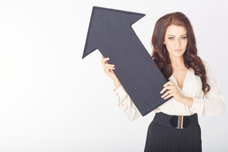 speculate: a businesswoman with a black arrow pointing up Stock Photo