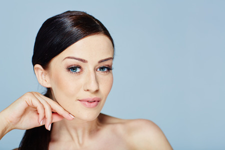 woman with a beauty face in studio Фото со стока