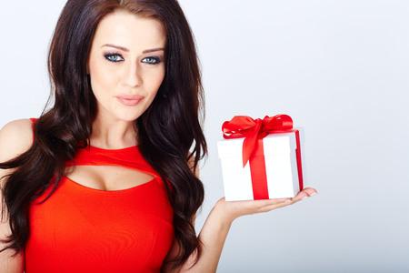 brunett: Fashion photo of luxury brunett with a gift