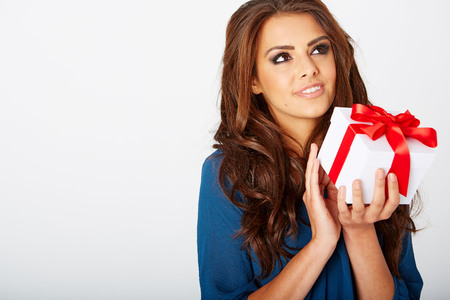 smile face: woman with a present in a blue dress Stock Photo