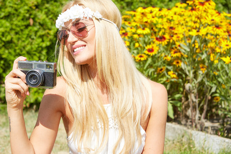 blonde females: portrait of a smiling young girl making selfie photo in park Stock Photo