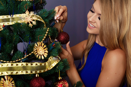 decorating: bright picture of woman decorating christmas tree Stock Photo