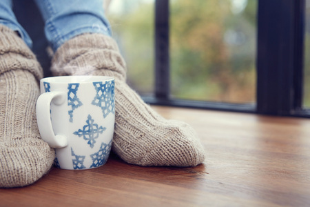 woman relax: Close up on feet. Winter and Christmas holidays concept. Stock Photo
