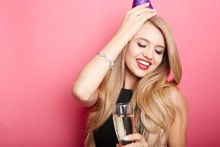 girl party: Young celebrating woman black dress, holding a glass of champagne. Stock Photo