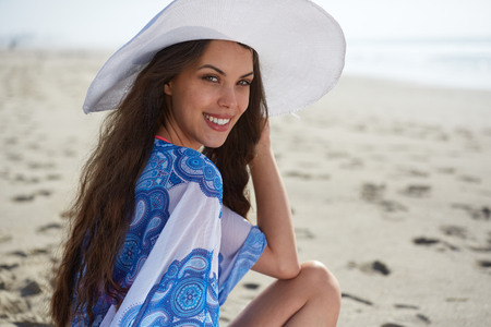 beautiful model: Close-up Of Beautiful Young Woman At Beach Wearing Hat