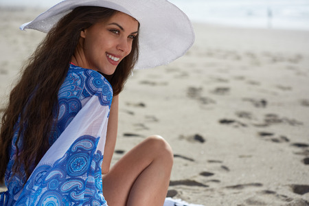 sea beach: Close-up Of Beautiful Young Woman At Beach Wearing Hat