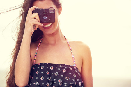 camera girl: Close up Portrait of beautiful  woman with retro hipster camera having fun at the beach