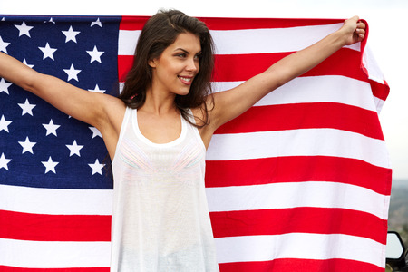 woman holding USA flag outdoor, independence day, 4th of july Standard-Bild