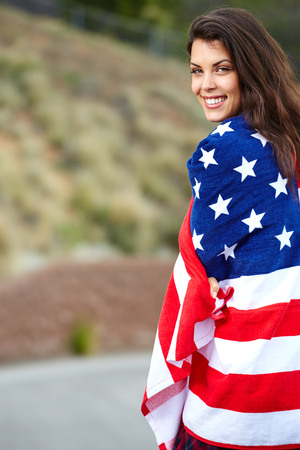 united states: Woman wearing American Flag, walking on the street Stock Photo