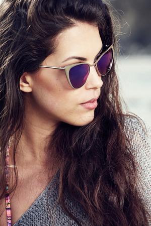sun glasses: woman with retro sunglasses at the beach