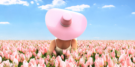 Spring woman with a hat laying in a field of tulips. 3d rendering Zdjęcie Seryjne